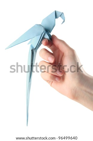 origami blue parrot sitting on the hand - stock photo