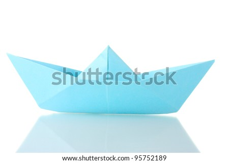 Origami boat out of the blue paper isolated on white