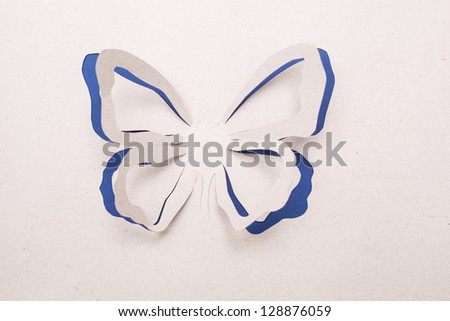 Origami butterfly on the gray background. - stock photo