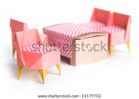 Origami chairs and table on a white background - stock photo
