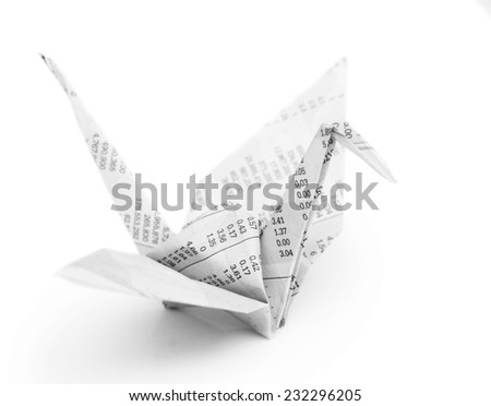 Origami crane bird  from recycle newspaper on white background - stock photo