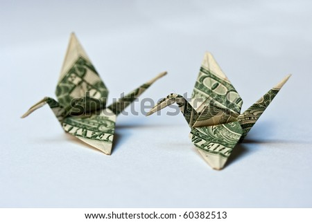 origami crane from a money note
