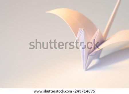 Origami crane lying on the side - stock photo