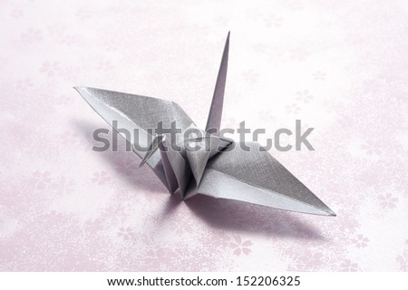 origami crane on japanese paper background - stock photo