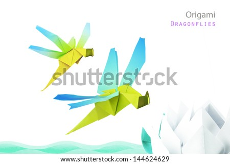 Origami dragonflies and river waves with lotus on white background - stock photo
