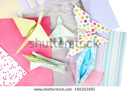 Origami figures and color papers, close up - stock photo