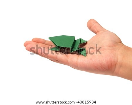 Origami frog on hand over white - stock photo