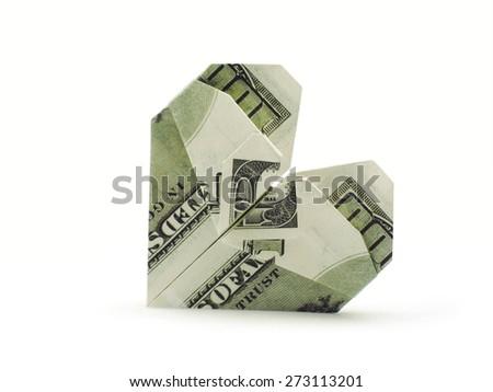 origami heart of hundred dollar banknotes - stock photo