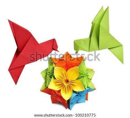origami hummingbird over flower kusudama over white background - stock photo
