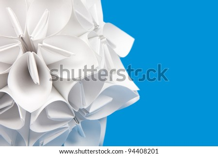 Origami on blue background - stock photo