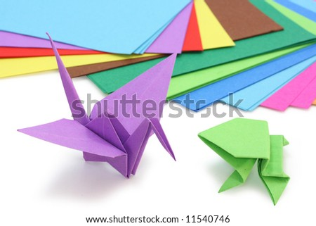 origami paper and figures on white - stock photo