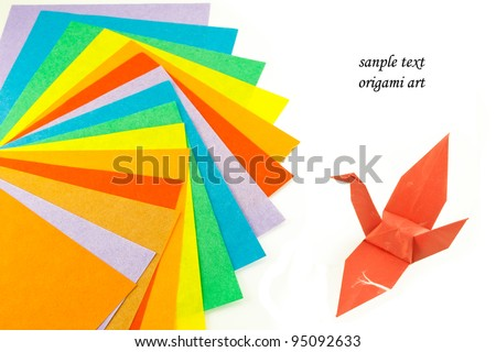 Origami paper and origami bird - stock photo