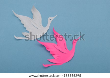 Origami paper bird on blue background.  - stock photo