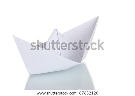 Origami paper boat isolated on white - stock photo