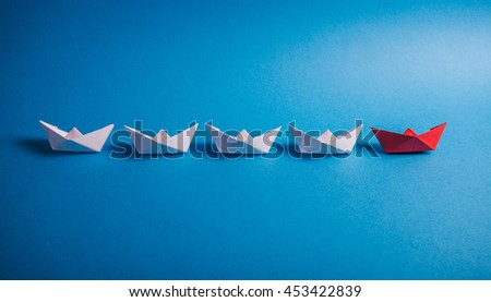Origami paper boats. Concept for leadership, management, business, motivation, difference and uniqueness. - stock photo
