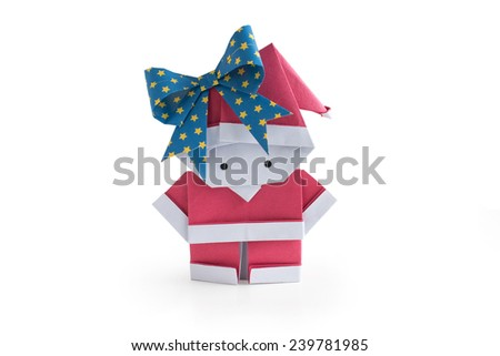 Origami paper craft Santa Claus (girl) isolated on a white background - stock photo