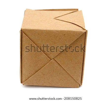 origami paper cube over white
