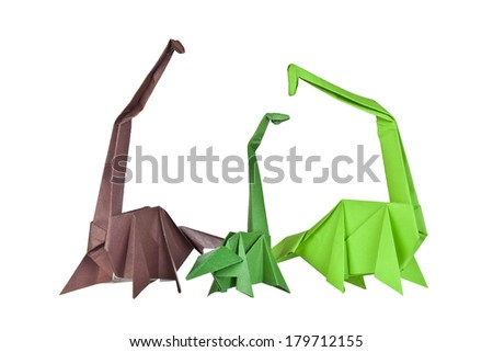 Origami. Paper figures of dinosaurs. Traditional Japanese art folding of figures from paper
