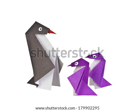 Origami. Paper figures of penguins. Traditional Japanese art folding of figures from paper - stock photo