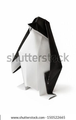 Origami penguin on a white background. - stock photo