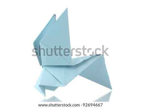 Origami pigeon out of the blue paper isolated on white