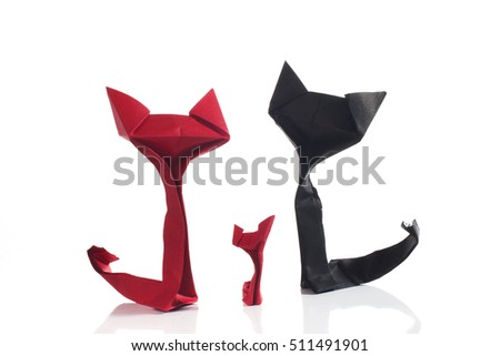 Origami red and black paper cats over a white background. Family scene.
