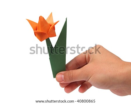 Origami tulip on hand over white - stock photo