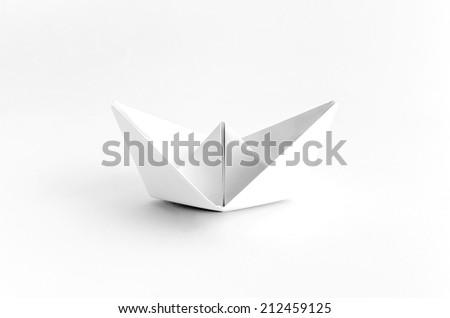 Origami White Paper Boat on White Background - stock photo