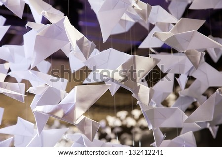 Origamis. Traditional Japanese art of folding from paper of figures of animals and birds - stock photo