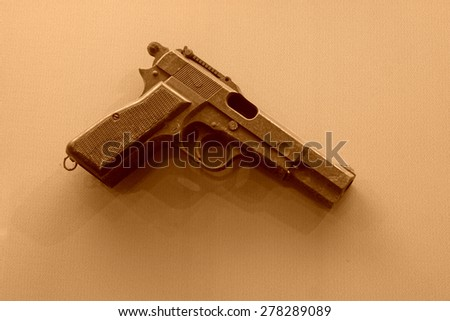 original abandoned pistol in a museumj, closeup of photo