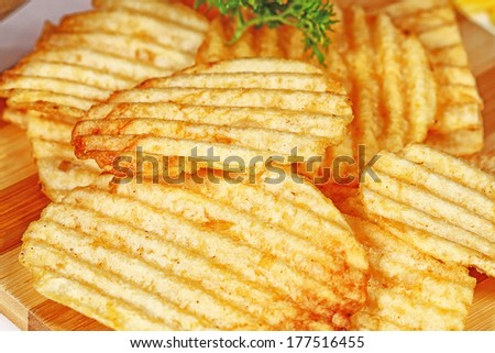 original and flavored potato chips, isolated on white