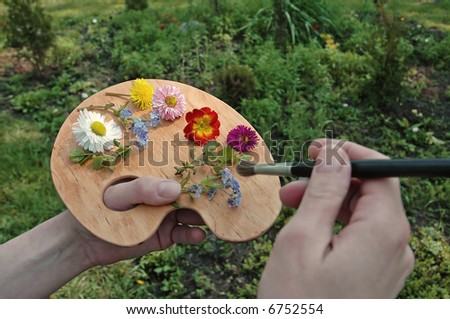 original artist's palette with flowers instead of colors - stock photo