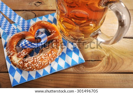 original bavarian salted soft pretzel with Oktoberfest beer mug on napkin from Germany
