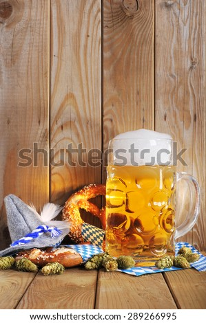 original bavarian soft pretzels with Oktoberfest beer mug and costume hat from Germany - stock photo