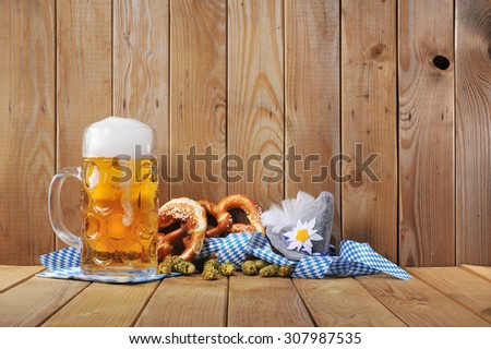 original bavarian soft pretzels with Oktoberfest beer mug and costume hat from Germany