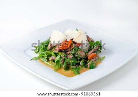 Original beefsteak with rucola and parmesan - stock photo