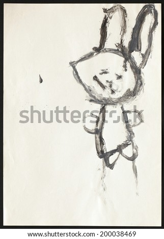 Original child's drawing of a black rabbit drawing by a five-year-old girl.  - stock photo