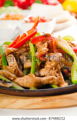 original fajita sizzling smoking hot served on iron plate and fresh vegetables on background ,MORE DELICIOUS FOOD ON PORTFOLIO - stock photo