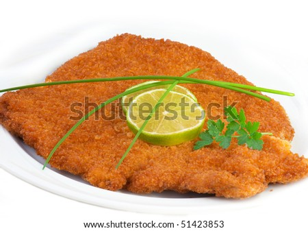 Original fried breaded Veal Viennese (could be either veal, pork or chicken schnitzel) - stock photo