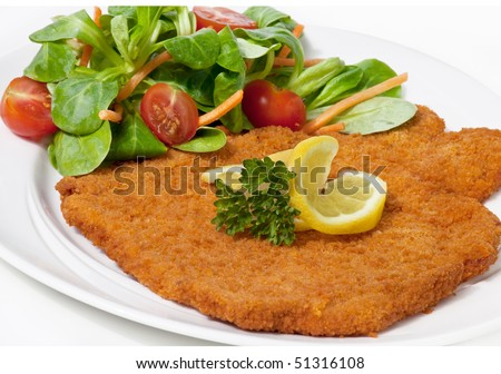 Original fried breaded Veal Viennese with Salad (could be either veal, pork or chicken schnitzel) - stock photo