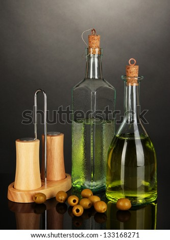 Original glass bottles with oil isolated on black