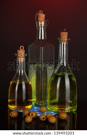 Original glass bottles with oil on dark color background