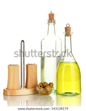 Original glass bottles with salad dressing isolated on white