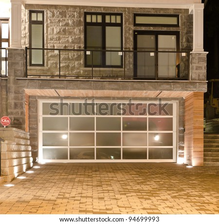 Original (glass) garage doors at the night (dick) time. - stock photo