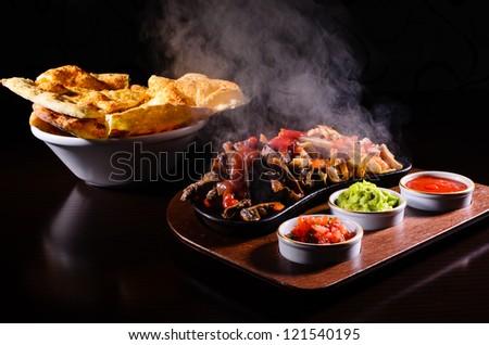 Original hot fajita served on wood plate - stock photo