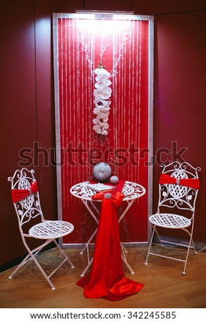 Original luxury modern wedding decoration metal sphere with diamonds and red ribbon - stock photo
