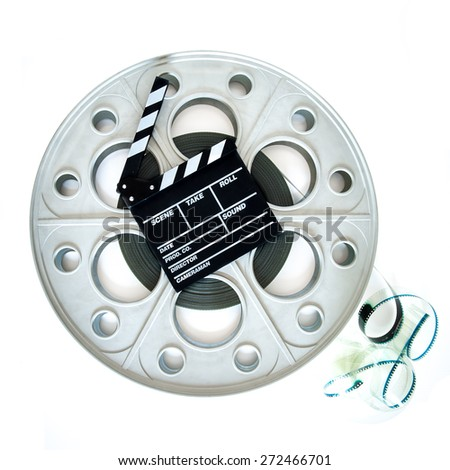 Original old big movie reel for 35 mm cinema projector loaded with film, with clapper board on neutral background, square format - stock photo