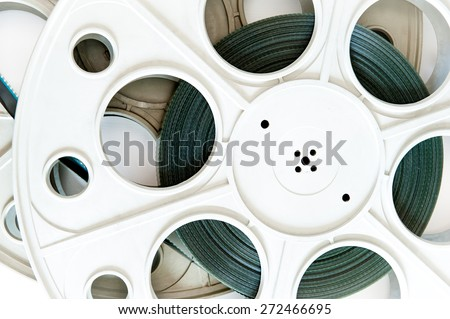 Original old big movie reel for 35 mm film projector film loaded detail on neutral background - stock photo