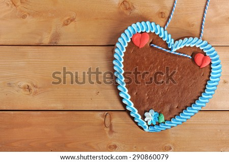 original unlabeled bavarian gingerbread heart from Germany on old weathered wooden board