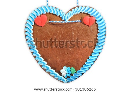 original unlabeled Bavarian gingerbread heart from Germany on white background - stock photo